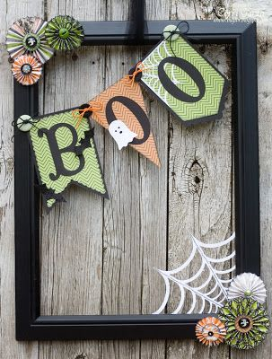 using an open picture frame do this with different colors and themes for each holiday