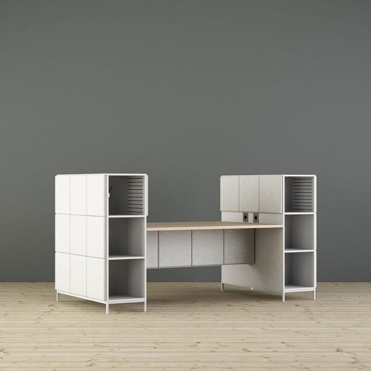 Sabine acoustics workplace is a unique product for modern work situations. The table top in white stained ash rests on a sound absorbing technique beam connected by storage units. The workplaces can be connected in series. Socket for power, data, USB and HDMI at every workstation. The sides can be fitted with coat racks or shelves. Scandinavian design. Made in Sweden. Design - Bertil Harström | Johan Kauppi