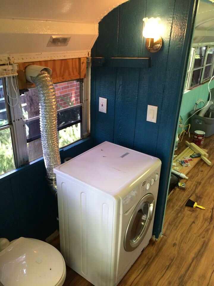 Washerdryer allinone in skoolie bathroom area  The