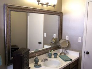 we will need to do this for the large mirror in the kitchen area probably a more modern style or a color for the frame