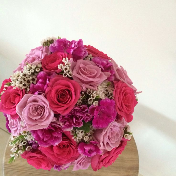 Bright bridal bouquet of local Canberra roses and carnations