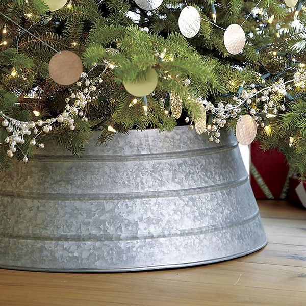 Industrial chic effortlessly blends together modern elements with a more relaxed, comfy vibe. This galvanized tree collar is an excellent alternative to a tree skirt and will help protect your wood floors from spills when you refill the water for your tree. | Christmas Items and Holiday Items for Your Wedding Registry