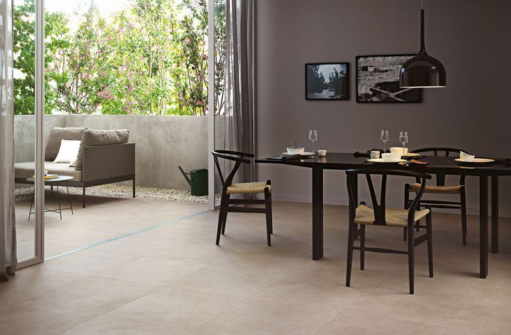 Elegant dining area at home. Floors - Landscape tile collection from Marazzi.