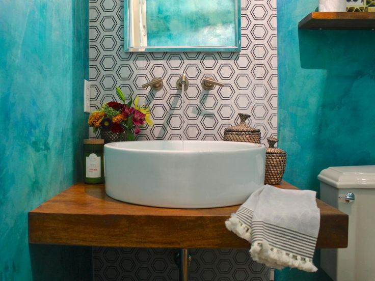 HGTV Loves This Contemporary Teal Powder Room That Features A Round Basin  Sink, Wood Countertop And A Patterned Tile Accent Wall.
