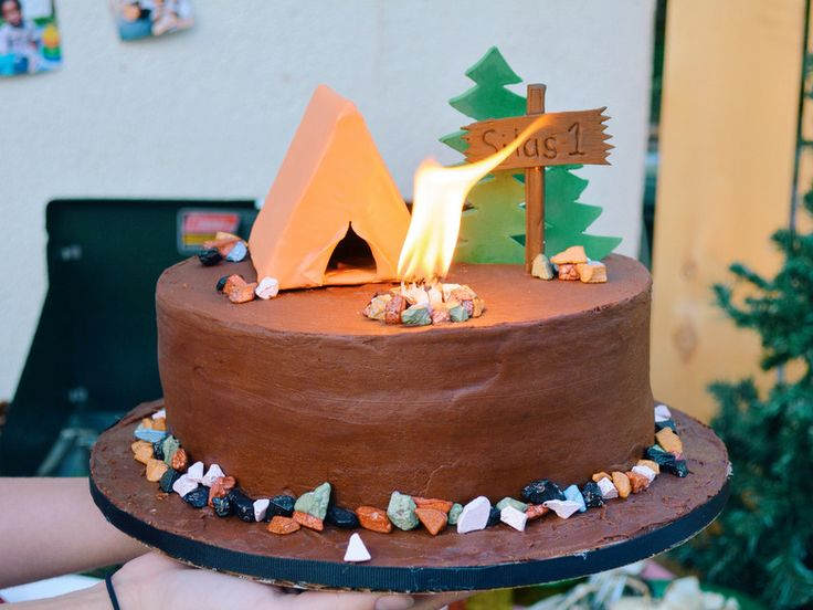 What a cute smash cake for @melindaann son's camping themed first birthday party.