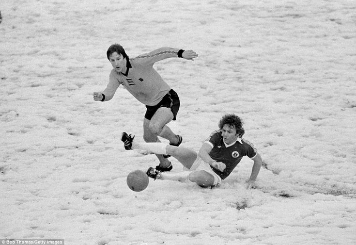 Everton striker Andy King slides in to tackle Steve Daley of Wolverhampton Wanderers during their First Division match played on a snow covered pitch at Molineux in Wolverhampton, 3rd February 1979. Wolverhampton Wanderers won 1-0. (Photo by Bob Thomas/Getty Images)