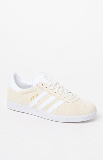 A classic indoor soccer shoe gets a modern rendition in the adidas Gazelle Sneakers. These women's sneakers are defined by a pigskin leather upper that lends a smooth, suede feel, a cream/white wash, thick rubber sole and serrated 3-Stripes at the sides.   	Lace-up 	Low profile 	Pigskin leather upper 	Synthetic lining for comfort 	Synthetic 3-Stripes and tongue 	Rubber outsole 	Imported
