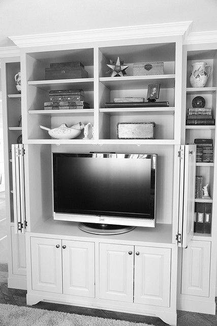 library wall unit with doors to cover up the tv