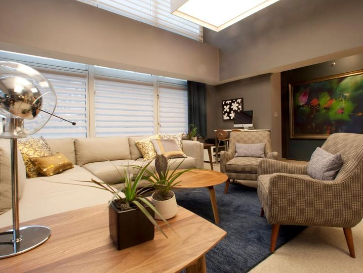 This Stylish Gray Living Room Features A Beige Sectional, Pair Of Chairs,  Round Wood Part 71