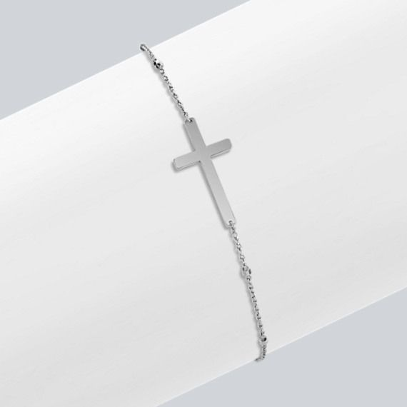 This darling and inspirational sideways cross bracelet is crafted from quality 14 karat Italian white gold and features shimmering white gold stations on the seven and 1/2 inch chain.