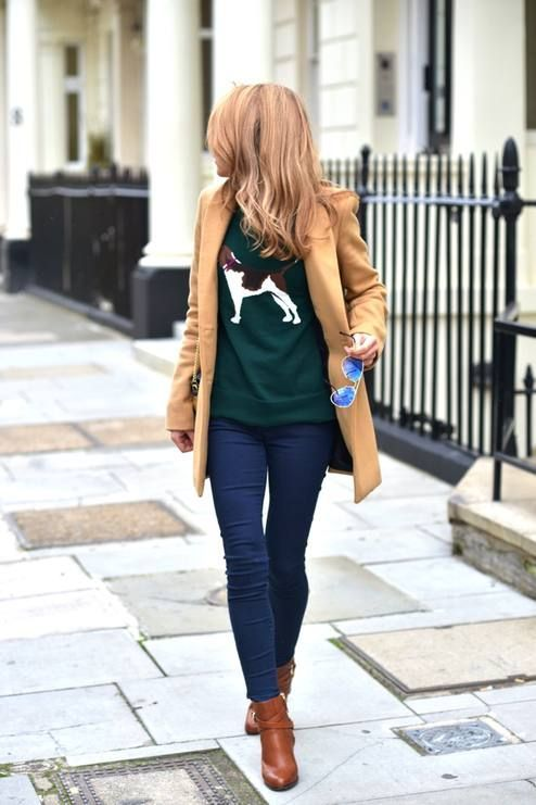 Rock a camel coat with dark blue skinny jeans for a standout ensemble. A pair of brown leather booties will seamlessly integrate within a variety of outfits.  Shop this look for $107:  http://lookastic.com/women/looks/ankle-boots-skinny-jeans-sunglasses-coat-crew-neck-sweater/4366  — Brown Leather Ankle Boots  — Navy Skinny Jeans  — Blue Sunglasses  — Camel Coat  — Dark Green Print Crew-neck Sweater