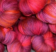 Lara Downs is a boutique yarn store, specialising in mohair and natural fibre yarns. These skeins are Romp in Red 8ply Merino, but seriously, they pale by comparison to the Angora Glow yarn and the silk blend yarns that are stocked at Lara Downs. We feature these yarns regularly in Yarn magazine and love them all.