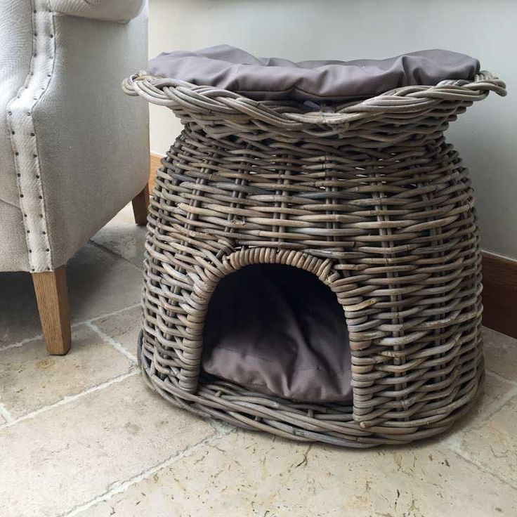 This luxury grey wicker cat house has a bed inside and out It has a cushion on top and a cushion inside so they can hide away if they feel like