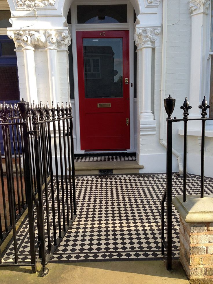 front garden victorian mosaic tile path with yorkstone step yellow brick wall and metal rails and stone effect wall caps chelsea london