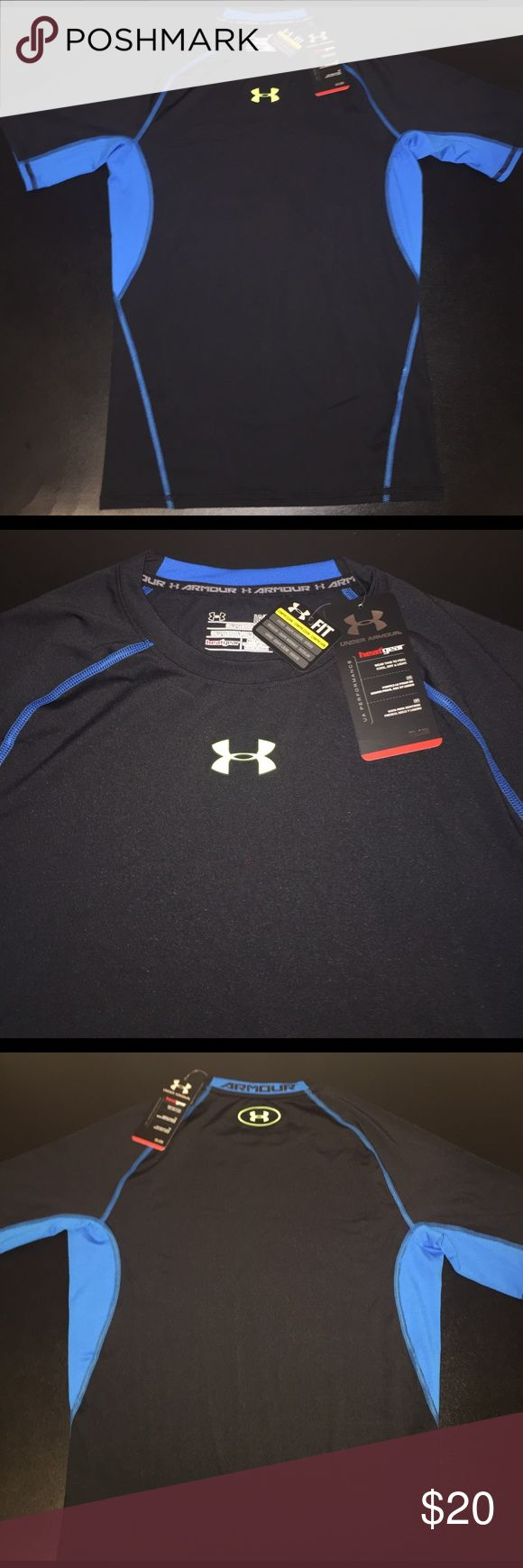 NWT Under Armour Men's Compression Heat Gear Shirt For sale is a NWT Under Armour Men's Compression Heat Gear Shirt. Item is in excellent condition, size Large and ready to be shipped. The top is black with blue accents and electric yellow UA logo. Under Armour Shirts Tees - Short Sleeve