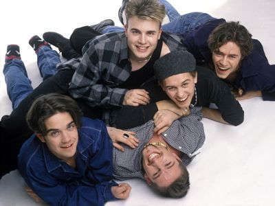 Robbie started in the boy band Take That in the mid 90's.