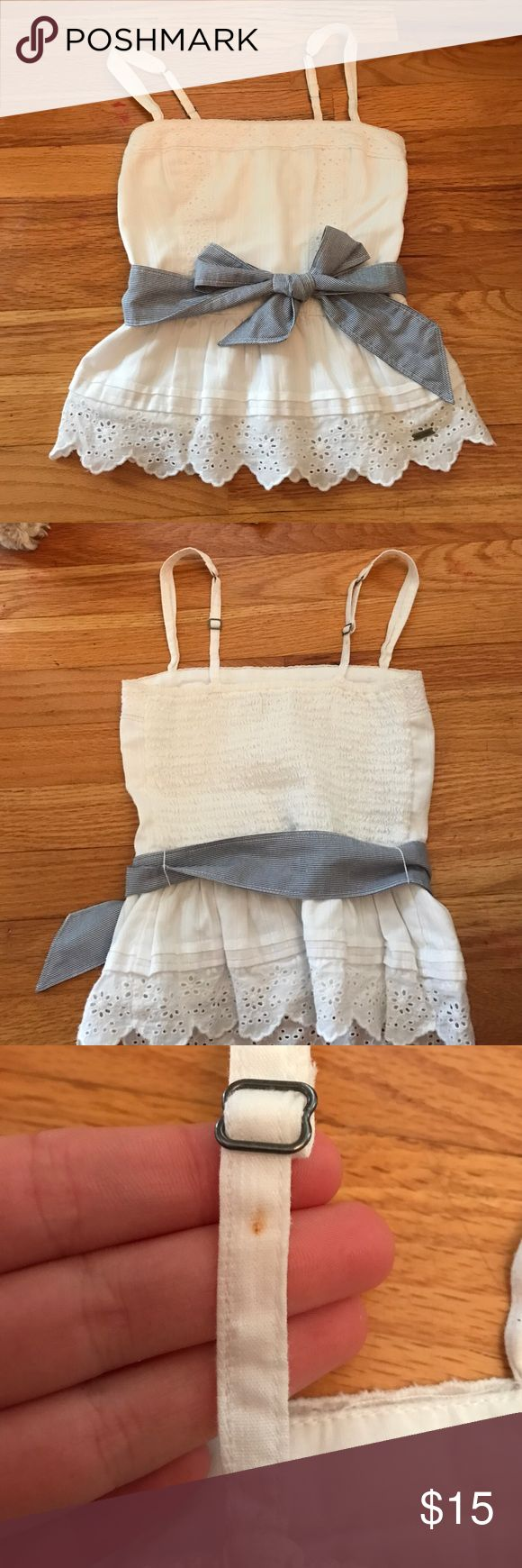 Abercrombie kids tank size medium Cute Abercrombie kids girls white tank with blue and white striped bow. Size medium.  Small spot on the back of the strap that is barely noticeable and can be covered with the adjustable silver piece abercrombie kids Shirts & Tops Tank Tops