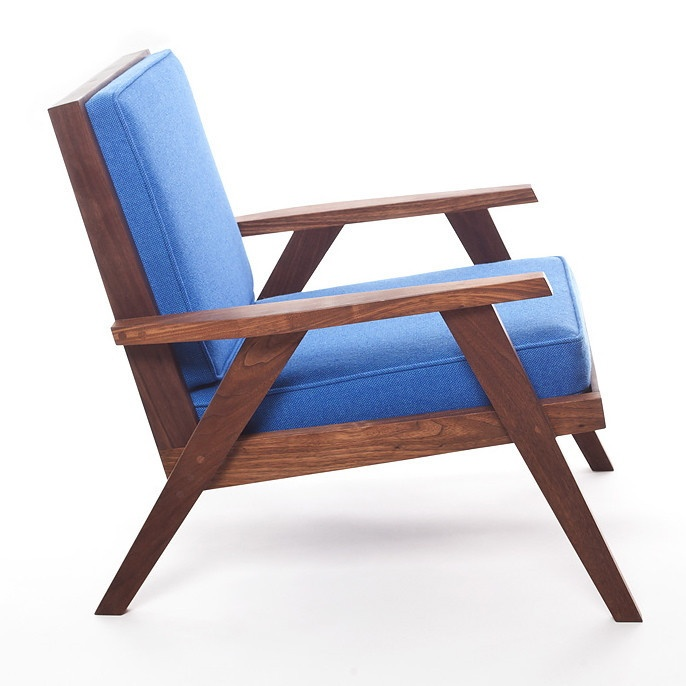 The Station Chair in blue Kvadrat Hallingdal fabric and solid walnut.