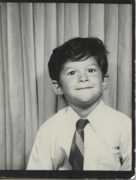 Vintage photo booth portrait. BRIGHT,STUDIOUS YOUNG BOY.