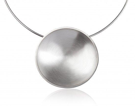 Giant planet; handmade necklace in argentium silver. Diameter: 5,5 cm.
