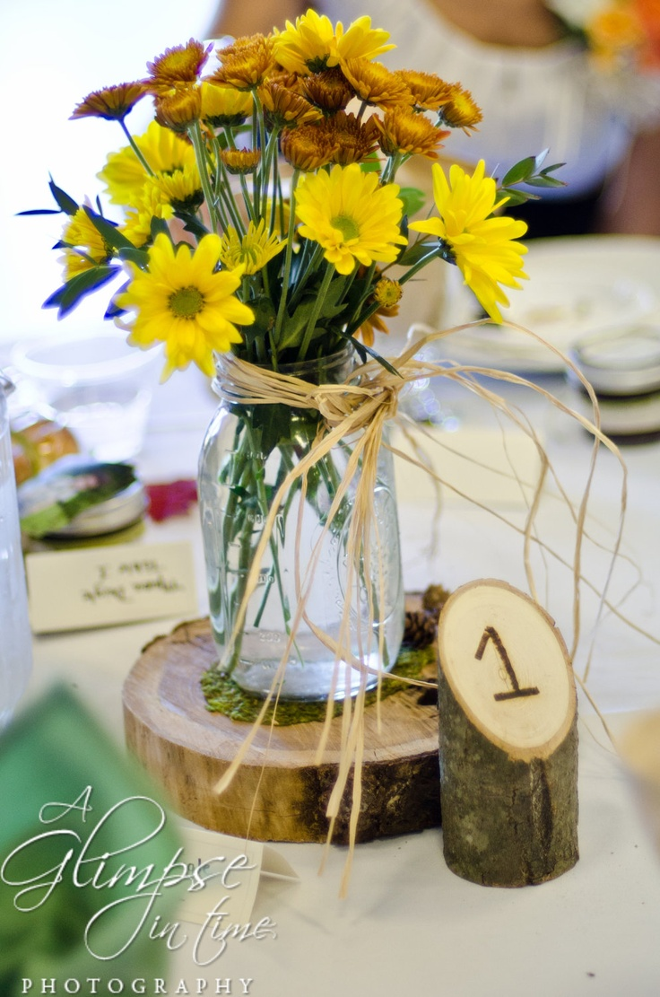 Rustic Wedding Log Table Numbers and Three Candle Center Pieces. $9.95, via Etsy.