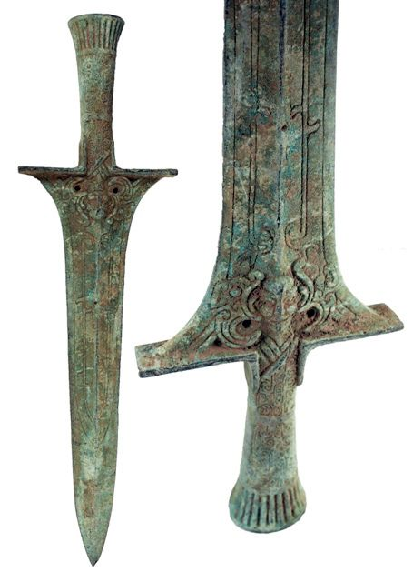 Asian Bronze Sword. Bronze sword with an incised human face, linear and spiral designs on both sides of the hilt and blade. 400-200 BC