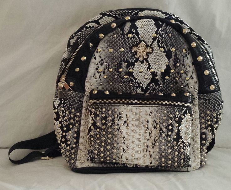 """""""AGTS"""" Logo  Snake Print with Fleur-de-lis Accent and Gold Studs Backpack  $65.00"""