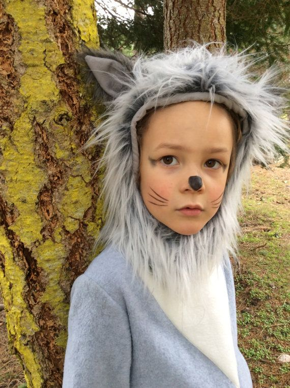Grey Wolf costume with furry hood and tail! great for a boy or girl. Made out of anti-pill polar fleece and faux fur. One Piece suit is easy to put on