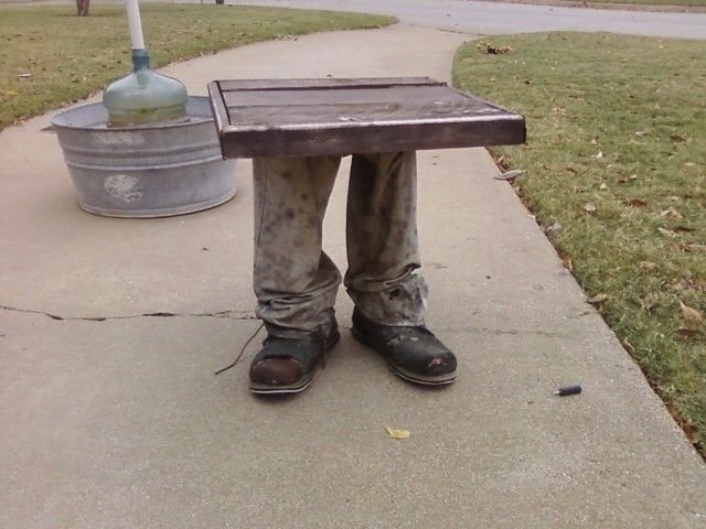 Make your own leg table. easy to make: cut 2x4's to heighth of knees, insert 2x4 to bottom of boots. Mix concrete, pour over 2x4 in boot & let dry. Cut pants to size, install over boots & then screw table top to top of 2x4; staple top of pants to bottom of table. The weight of the concrete makes the table sturdy.