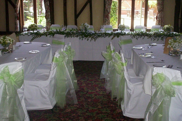 Spring Green Organza Bows on White Chair Covers
