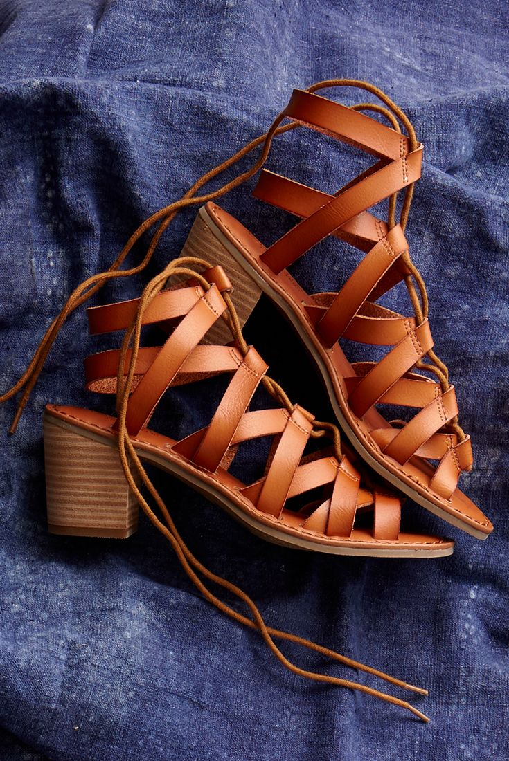 Our AEO Chunky Mid Heel Sandal is a summer staple. Shop now directly from the link in our bio.