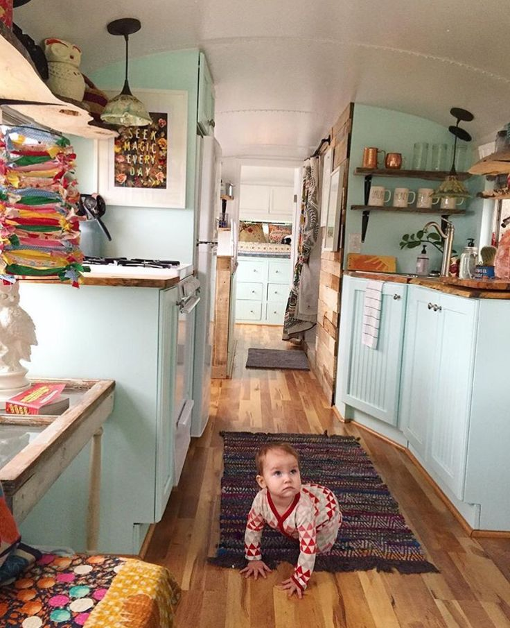 School bus? Love the wood floors and counters, the open shelves, the simple design, pops of color!