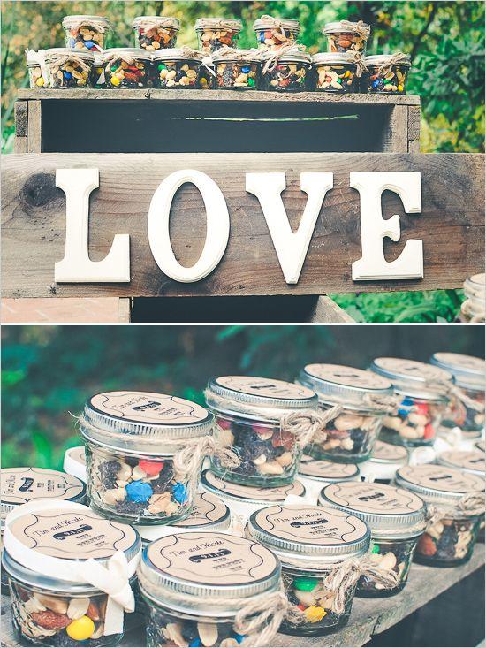 Trail Mix Wedding Favors at rustic wedding reception. ---> http://www.weddingchicks.com/2014/05/12/northern-california-farm-wedding/