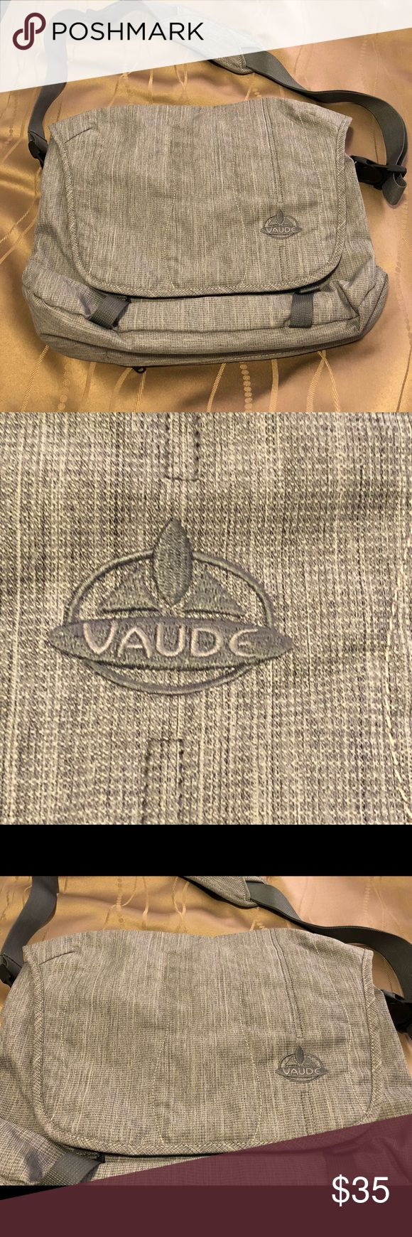 """Vaude Messenger/Laptop Bag Gray Vaude Messenger/Laptop Bag.  Durable fabric, with gray outside stitching, clean, and in great condition inside and out.  Mesh pockets inside.  Zippered pockets under front closure, back and bottom of bag.  Black durable hardware, and adjustable shoulder strap, in good condition.  Width 15"""" Length 11"""" Vaude Bags Messenger Bags"""