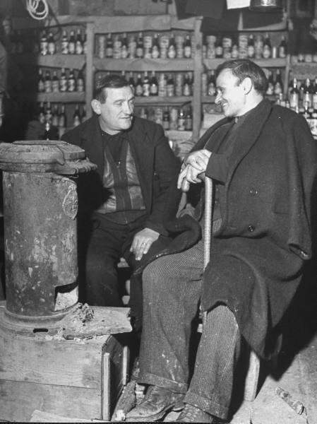 Civil War/Greece A village council member having a meeting with a man from San Francisco.Location:Louzesti, Greece Date taken:December 1947 Photographer:John Phillips