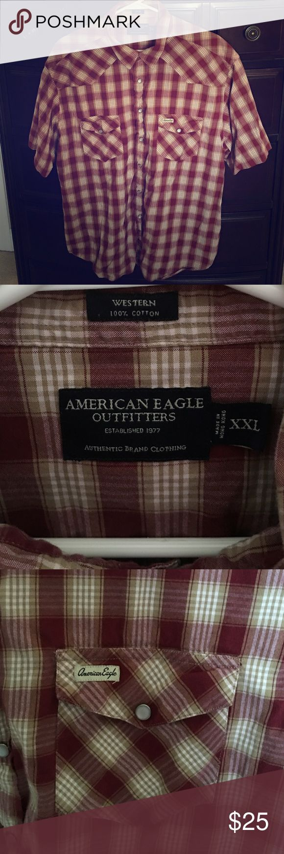 Men's American Eagle Outfitters plaid t-shirt The men's plaid American Eagles Outfitters t-shirt is an XXL. The plaid shirt buttons up the front. Two front pockets located on the chest. American Eagle Outfitters Shirts Tees - Short Sleeve