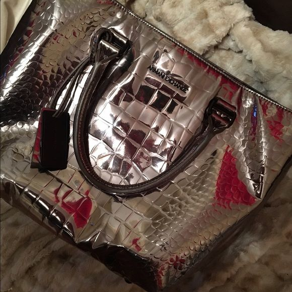 Armani Exchange Tote Mirror or Silver tote. Croc designs. Two side pockets one zipper pocket with the button snap. Very good used condition Armani Exchange Bags Totes