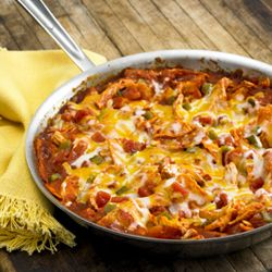 Chicken Enchilada Skillet ~ The flavor of an enchilada recipe made quickly in a skillet with torn corn tortillas, cooked chicken, zesty tomatoes and sauce with cheese