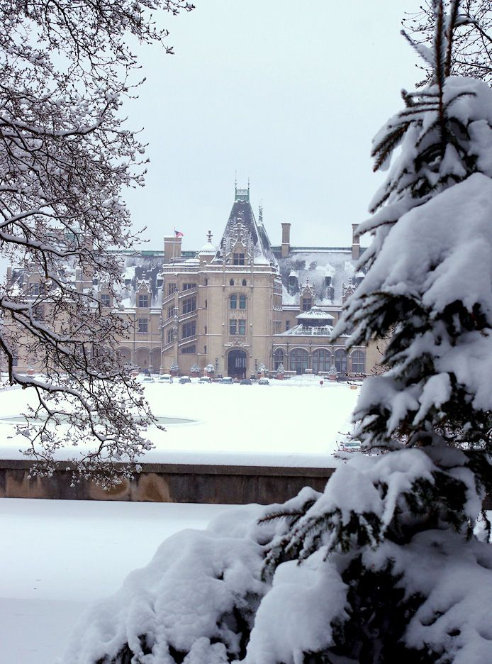 Biltmore House with snow laden trees in Asheville NC