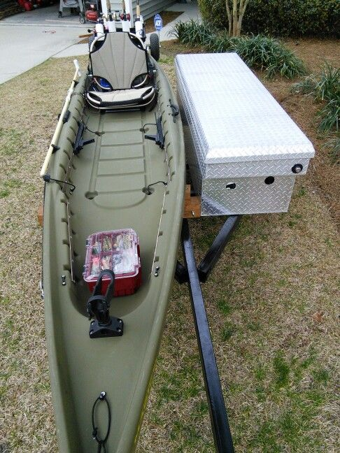 Rigged fishing kayak. On the trailer and ready to go.