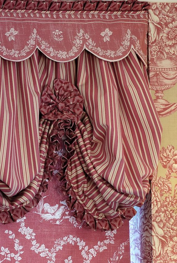 French General Look In Faded Red Roman Shade Under A Scalloped Valance With  Pleated Edge