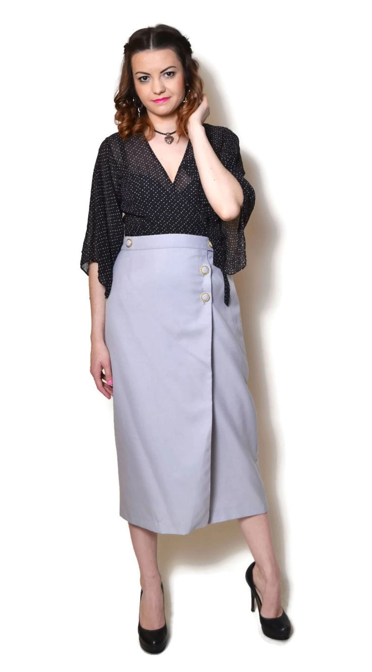 Vintage grey high waisted midi skirt. Shows some signs of wear.  The model on the pictures is size S/36 and 165 cm height. Please check measurements with your own to avoid problems with the size. Make sure you double the measurements where shown (*2):  Label size: M/ 38 Total lenght: 80 cm / 31.5 inches Waist: 37.5 cm *2 / 14.75 inches *2 Hips: 47 cm *2 / 18.5 inches *2 Bottom Width: 53.5 cm *2 / 21 inches *2  Condition: very good Colors: Grey Circa: 60s Pinned t...