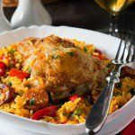 Instead of traditional seafood paella, try a this simple Chicken & Chorizo recipe. This hearty family dinner for four is a flavorful, one pot meal with chicken, Spanish sausage and saffron rice.