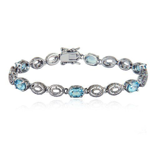 "Sterling Silver Blue Topaz Bracelet, 7.25"" Amazon Curated Collection. $59.00. Blue Topaz is December?s birthstone.. Gemstones may have been treated to improve their appearance or durability and may require special care.. The natural properties and composition of mined gemstones define the unique beauty of each piece. The image may show slight differences to the actual stone in color and texture.. Save 70% Off!"