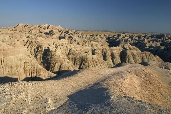 This dusty dry landscape is a perfect example of a desert the dry cracks in the ground are formed by shortages of water this is a very educational picture