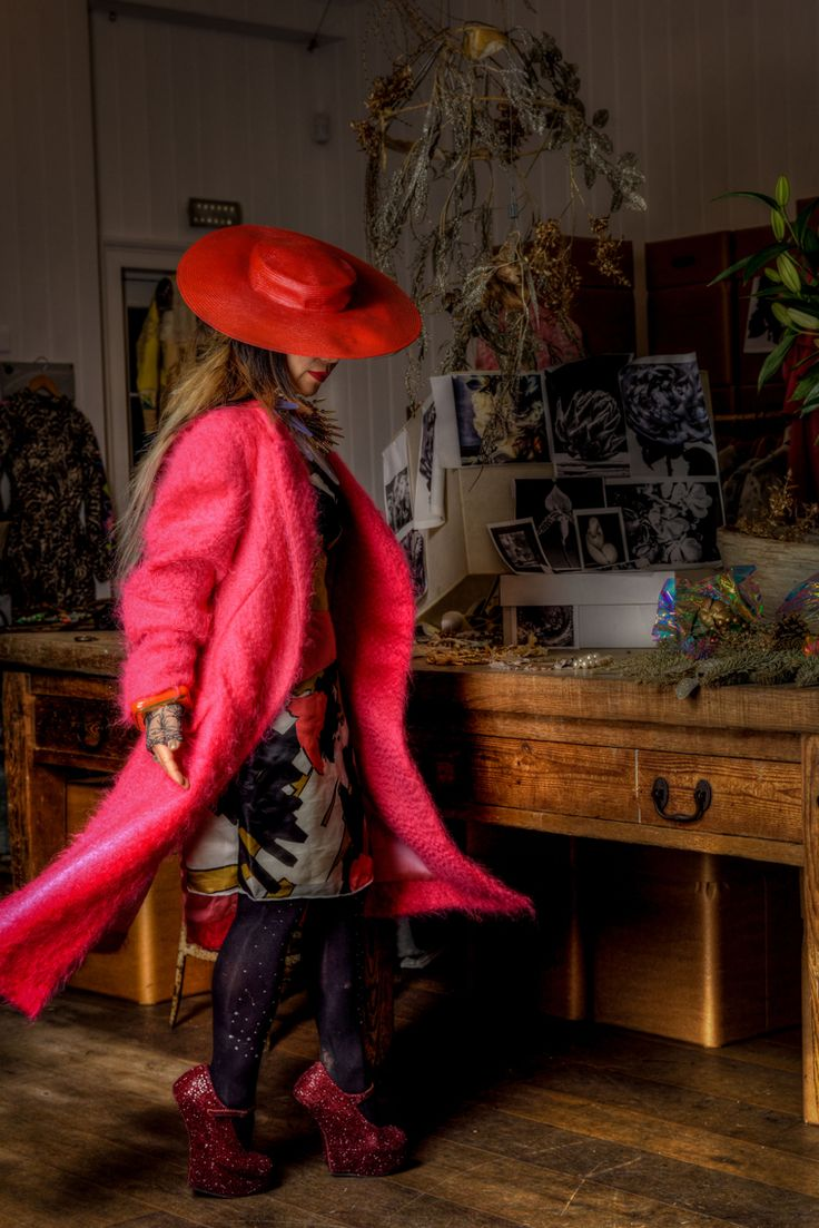 Photo by Ethan Lee in East London 123 Brick Lane gallery. Red hat by Noel Stewart Dress by Julian Smith