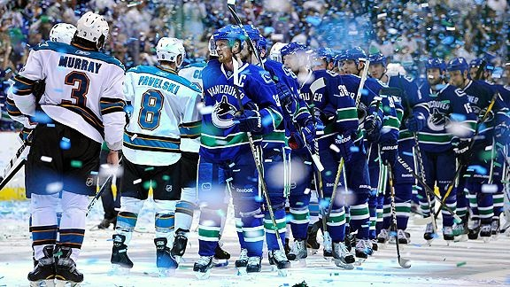 Love this shot of blurry confetti and team handshakes. Vancouver Canucks in the Stanley Cup final!