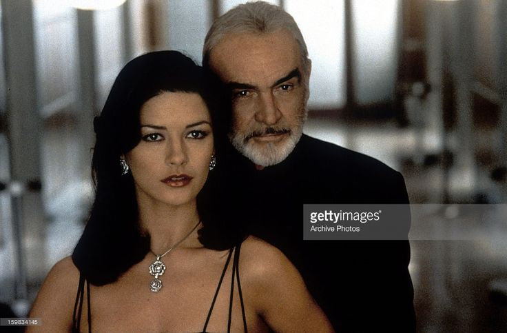 Sean Connery standing behind Catherine Zeta-Jones in a scene from the film 'Entrapment', 1999.