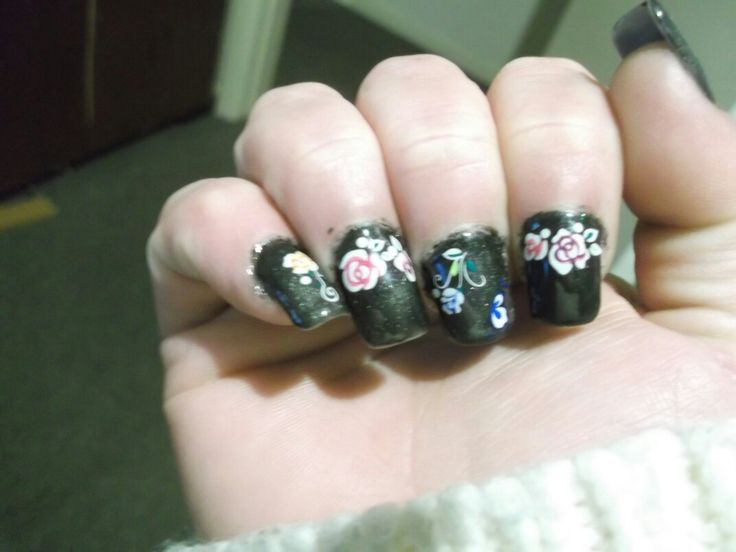 Black Catseye polish with flower decals