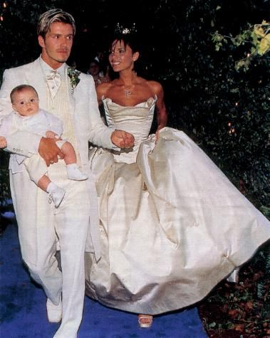 July 4, 1999: David and Victoria Beckham were already big stars when they wed at 16th Century Luttrellstown Castle near Dublin. Victoria wore Vera Wang, Becks wore ivory and cream for the ceremony, but changed into purple for the reception after the couple's infant son Brooklyn threw up on him. Footballer Gary Neville served as best man, and all four Spice Girls were in attendance. An 18pc. orchestra entertained a black-and-white reception, and the couple donated their 5-tier cake to…